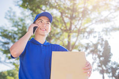 Deliveryman talk on phone Stock Image