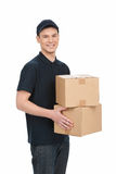 Deliveryman at work. Cheerful young deliveryman holding a box st Royalty Free Stock Images