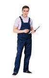 Deliveryman writing on a tablet Stock Images