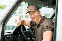 Deliverymen Showing Thumb Up Sign In Van Royalty Free Stock Photo
