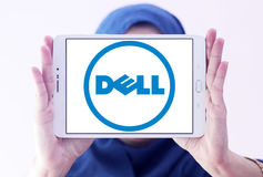 Dell logo. Logo of dell company on samsung tablet holded by arab muslim woman Royalty Free Stock Images