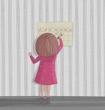 Della ragazza del cancellare giorno sul calendario Immagine Stock