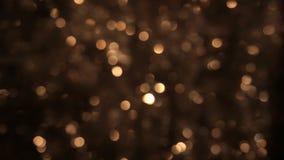 Dello sfarfallamento del lamé dell'oro è sfuocato Natale fondo, lamé video d archivio