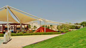 Delma Park in Abu Dhabi - steel structure with tends. Steel structure with tends and artificial hills in different colors Royalty Free Stock Images