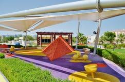 Delma-Park - neigt, den Spielplatz der Kinder verschüttend Lizenzfreie Stockbilder