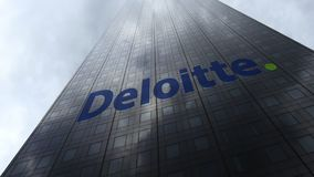 Deloitte logo on a skyscraper facade reflecting clouds. Editorial 3D rendering Stock Images
