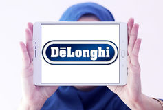 DeLonghi logo. Logo of DeLonghi company on samsung tablet holded by arab muslim woman. De`Longhi is a leading brand in home appliances, Coffee makers, kitchen Royalty Free Stock Image