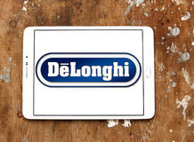 DeLonghi logo. Logo of DeLonghi company on samsung tablet on wooden background. De`Longhi is a leading brand in home appliances, Coffee makers, kitchen Stock Image