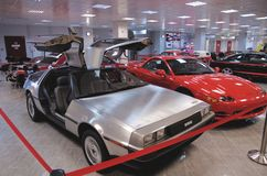 A DeLorean DMC-12 from the front with the gull-wing doors open Stock Photos