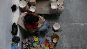 Delores Hidalgo, Μεξικό 10 Ιανουαρίου 2017: Άνθρωποι που χρωματίζουν την αγγειοπλαστική απόθεμα βίντεο