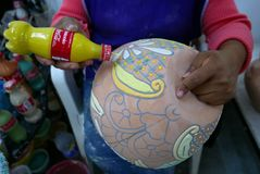 Delores Hidalgo, Mexico-January 10, 2017: Men Painting Pottery. Woman Painting Pottery to be sold in markets Royalty Free Stock Photography