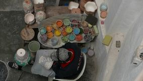Delores Hidalgo, Mexico-January 10, 2017: People painting pottery stock video footage