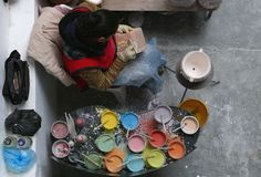 Delores Hidalgo, Mexico-January 10, 2017: Woman Painting Pottery. Woman Painting Pottery to be sold in markets Stock Photo