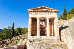 Delphi ancient sanctuary, Greece. The Treasury of Athens or Athenian Treasure in Delphi. Delphi is ancient sanctuary that grew rich as seat of oracle that was royalty free stock image