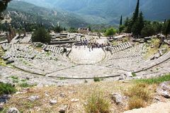 Ancient Greek Theater in Delphi. DELPHI, GREECE - SEPTEMBER 19, 2012: This is the ruins of the ancient Greek theater on the territory of the archaeological stock photography