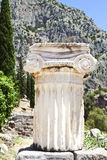 Delphi Ruins, Greece. Delphi, Greece, restoration site featuring detailed Greek column in foreground Royalty Free Stock Images