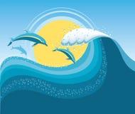 Delphine in der blauen Seewelle. Lizenzfreies Stockfoto