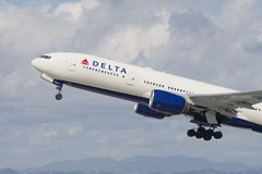 Delta Air Lines Boeing 777. Delta Air Lines aircraft Boeing 777 shown departing the Los Angeles International Airport LAX to Shanghai PVG royalty free stock photo