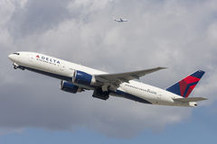 Delta Air Lines Boeing 777 airplane taking off from Los Angeles International Airport. Royalty Free Stock Images