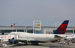 Delta Airline Boeing 747 at the gate at the Terminal 4 at John F Kennedy International Airport in New York. NEW YORK- JULY 10: Delta Airline Boeing 747 at the Royalty Free Stock Images