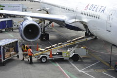 Delta Airline Plane Being Loaded with Freight Stock Photo