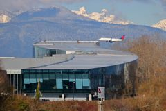 BCIT School of Transportation. A Delta Airliner passes BCIT`s school of transportation, the largest Aerospace Technology campus in Canada on February 22, 2018 royalty free stock image