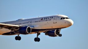 Delta Airlines Airbus A320 coming in for a landing royalty free stock photography