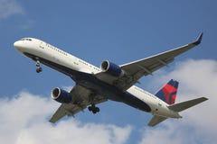 Delta Airlines Boeing 757 descending for landing at JFK International Airport in New York. NEW YORK - AUGUST 13, 2015: Delta Airlines Boeing 757 descending for Royalty Free Stock Photo