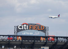 Delta Airlines jet flying over Citi Field, home of major league baseball team the New York Mets Royalty Free Stock Photography