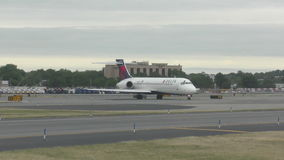 Delta airlines jet in 4K. New York, USA - May 29, 2015: Delta Airlines passenger jet airplane awaits takeoff at New York's LaGuardia airport. New York's airports stock footage