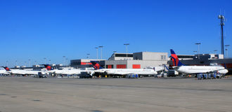 Delta Airlines jets at their terminal gates. Stock Photo