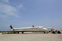 Delta Airlines McDonnell Douglas MD-80 and US Airways jet at Owen Roberts International Airport at Grand Cayman. GRAND CAYMAN, CAYMAN ISLANDS - June 13: Delta royalty free stock photo