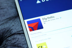Delta airlines mobile app. Downloading Delta airlines mobile app from google play store on samsung tablet stock photography