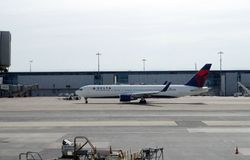 Delta Airlines plane just left the hub after embarking all passengers. Ready for departure royalty free stock photo
