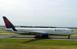 Delta Airlines plane on the runway ready to take off for a long journey. stock photos