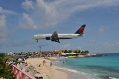 Delta airplane landing in Saint Maarten Royalty Free Stock Photo