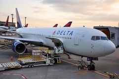 Delta Boeing 767-332(ER) in airport, in Tokyo, Japan. Delta Boeing 767-332(ER) in airport at sunset at Tokyo Haneda Airport (HND Stock Photos