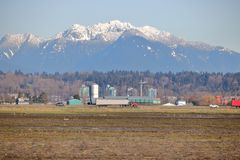 Delta British Columbia and Mountains. A scenic view of the rural are of Delta, British Columbia and the snow capped mountains on the north shore Stock Photography