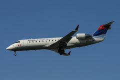 Delta Connection CRJ200 landing Stock Photo