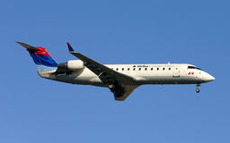 Delta Connection CRJ200 landing Royalty Free Stock Photography