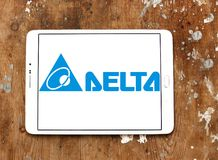 Delta Electronics company logo. Logo of Delta Electronics company on samsung tablet on wooden background. it is one of the world`s leading producer of power royalty free stock image