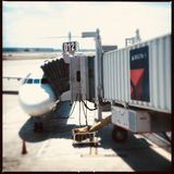Delta plane at gate Stock Images