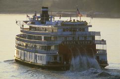 The Delta Queen, a relic of the steamboat era of the 19th century, still rolls down the Mississippi River Royalty Free Stock Photo