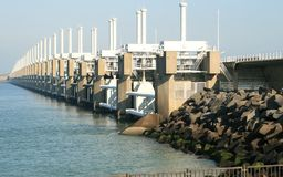 Delta Works in the Netherlands. The Oosterschelde storm surge barrier is part of the Delta Works in the Netherlands. It is an open barrier, which could be closed Royalty Free Stock Photography