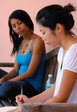 deltagare som studerar två Royaltyfria Foton