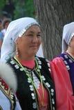 DeltagareSabantuy Tatar nationell dräkt Arkivfoto