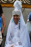 DeltagareSabantuy Tatar nationell dräkt Arkivbild