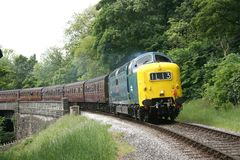 Deltic 55022 approaches Oakworth on the Keighley and Worth Valle. Y Railway, West Yorkshire, UK - June 2009 Royalty Free Stock Photo