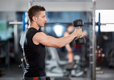 Delts workout with dumbbells Royalty Free Stock Photos