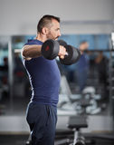 Delts workout with dumbbells Royalty Free Stock Image